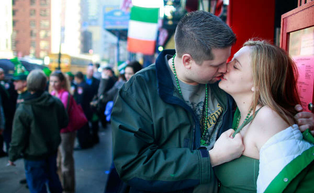 A couple kisses on Second Avenue after the 248th annual St. Patrick's Day parade March 17, 2009 in New York City.