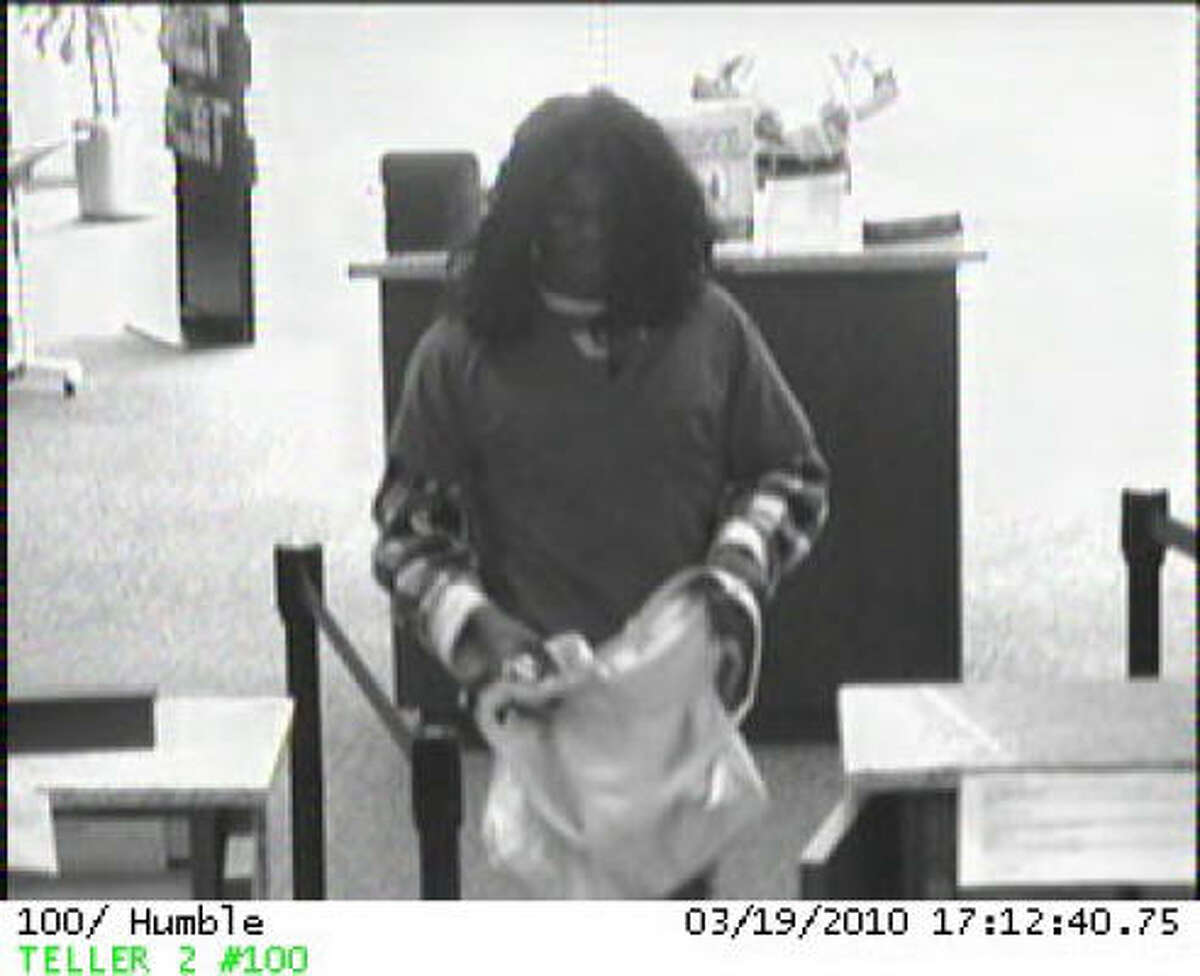 The Houston FBI Bank Robbery Task Force is seeking the public's assistance in identifying two men who wore wigs in an attempt to disguise their identity during a bank robbery. The bank's surveillance cameras captured several photographs of the duo as they robbed the Amegy bank, located at 9441 FM 1960 in Humble Texas.
