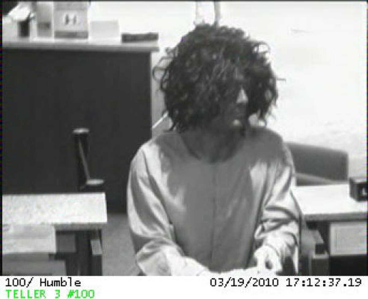 The Houston FBI Bank Robbery Task Force is seeking the public's assistance in identifying two men who wore wigs in an attempt to disguise their identity during a bank robbery earlier this evening. The bank's surveillance cameras captured several photographs of the duo as they robbed the Amegy bank, located at 9441 FM 1960 in Humble Texas.
