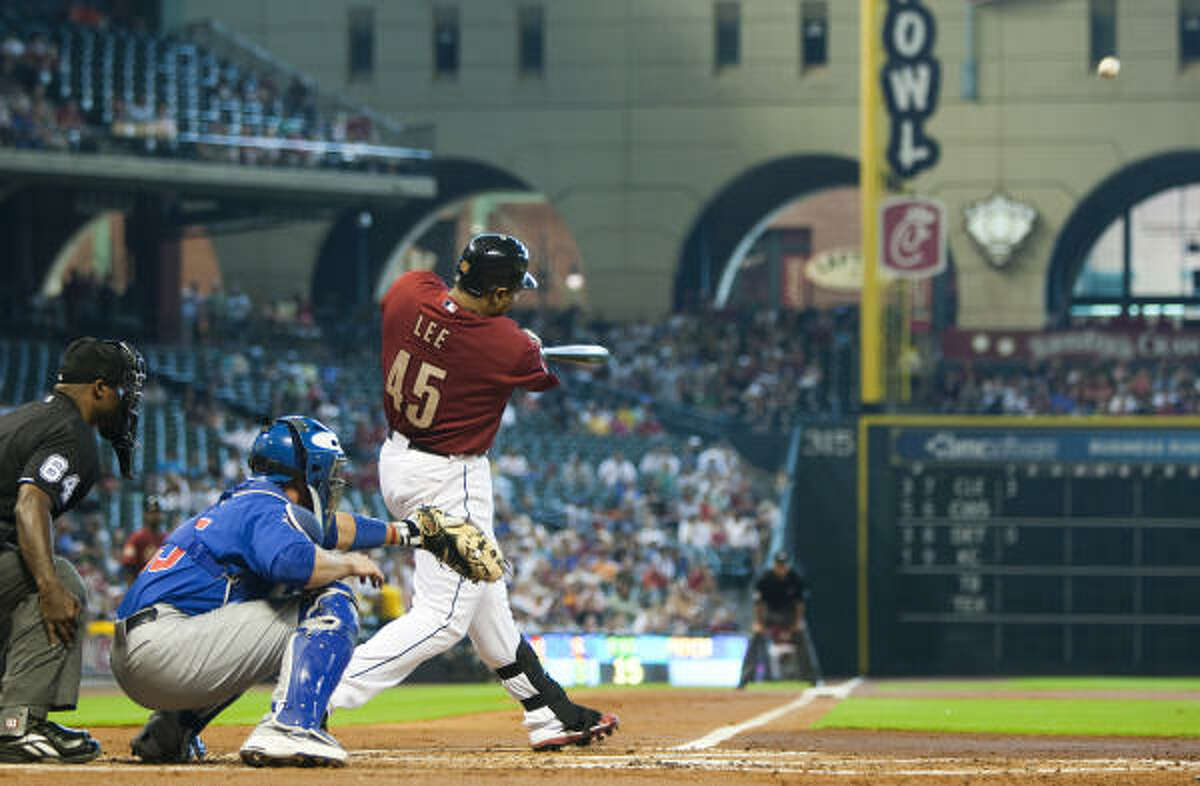 Carlos Lee (45) hits a two-run homer off Cubs starter Randy Wells during the first inning.