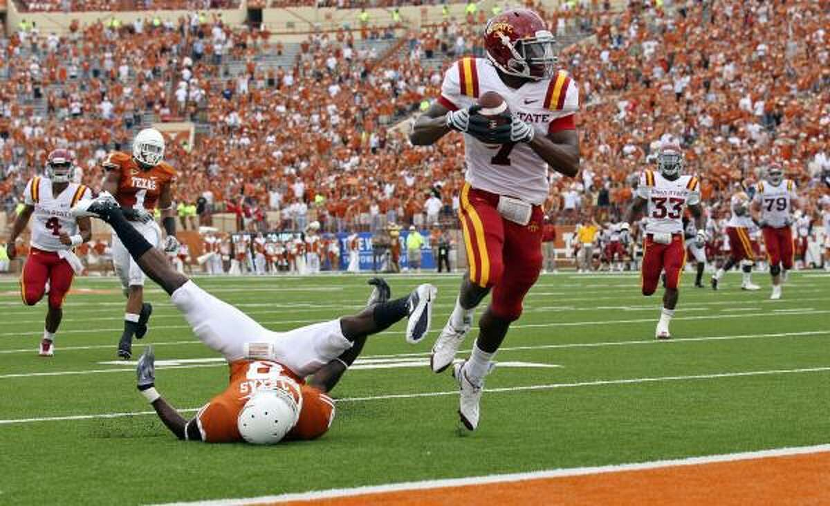 Iowa State's Darius Reynolds scores a touchdown in front of Texas' Chykie Brown.