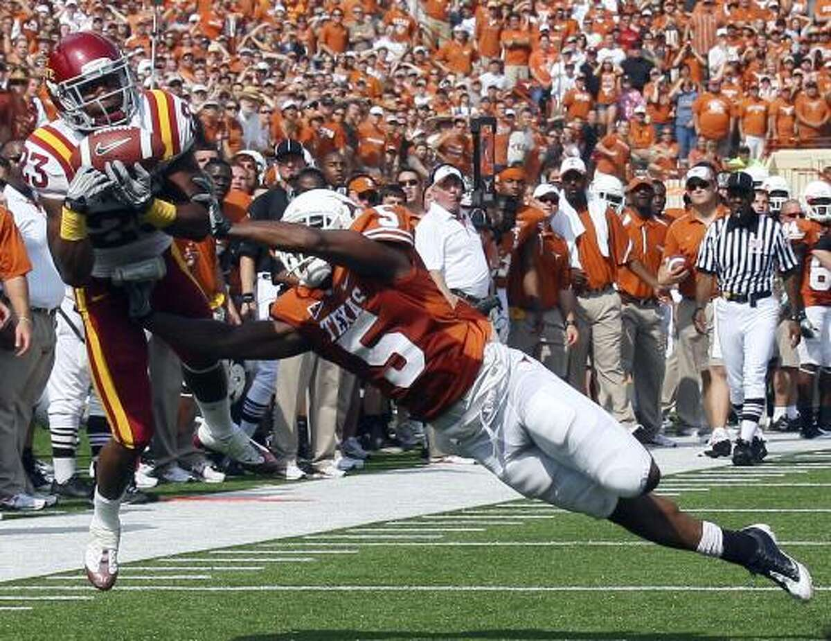 Iowa State's Leonard Johnson intercepts a pass intended for Texas' John Chiles.