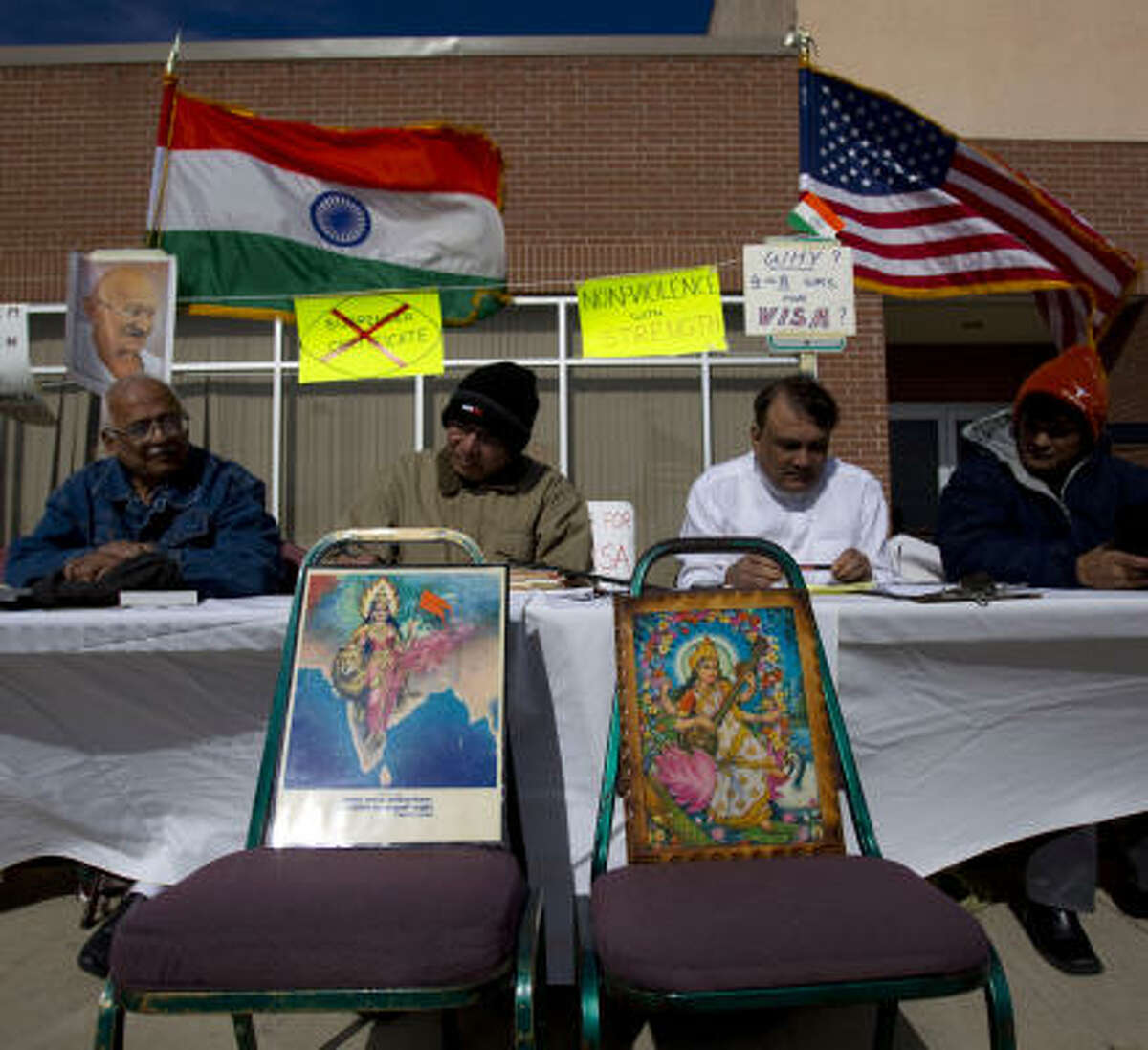 Lalit Chinoy, left, 74; Ramesh Shah, 66; P.V. Patel, 58, and P.M. Desai, 62, all fast for 24 hours and join about 30 others as they gather outside the Vallabh Priti Seva Samaj temple Sunday to protest against the Consulate General of India in Houston.