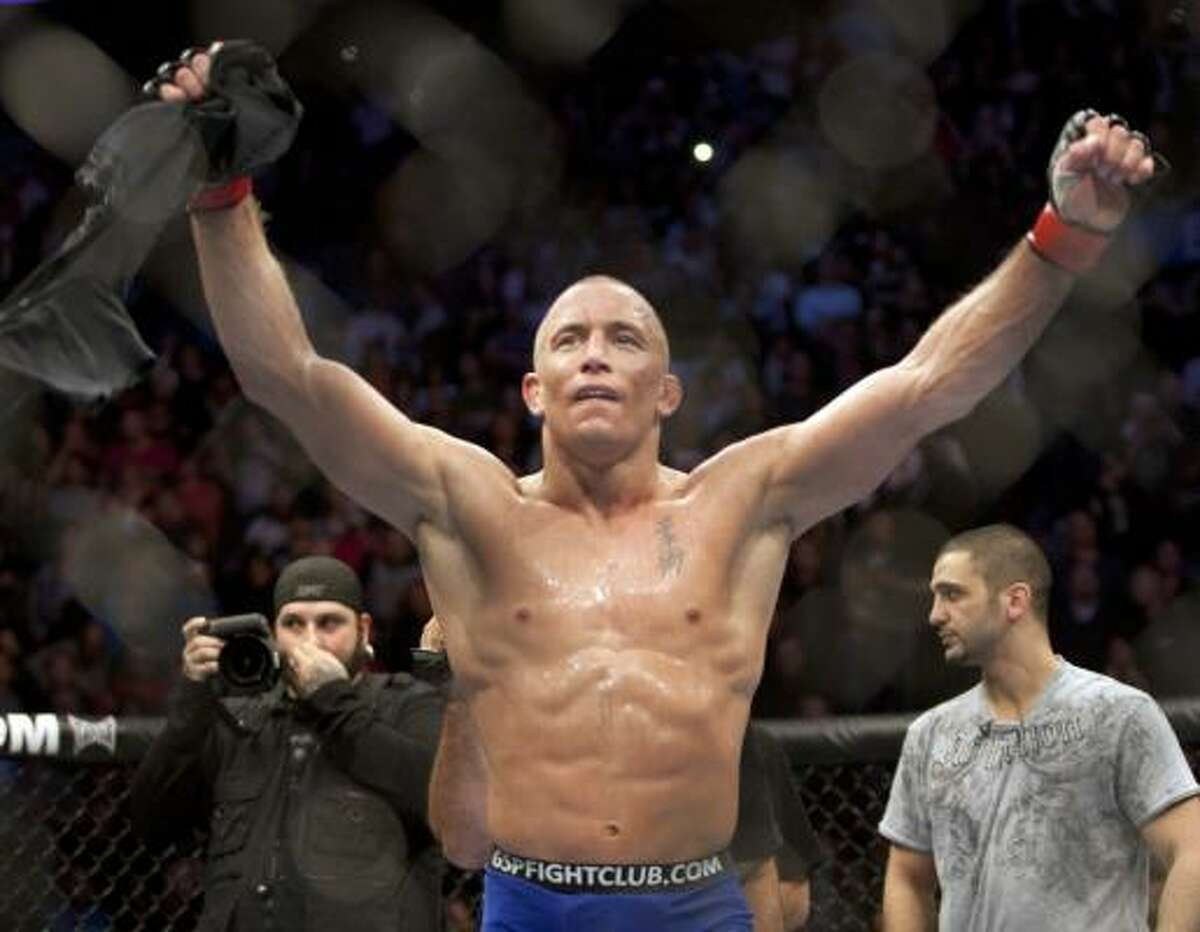 Georges St-Pierre, from Montreal, celebrates after defeating Josh Koscheck with a unanimous decision to retain his welterweight title at UFC 124 on Saturday night.