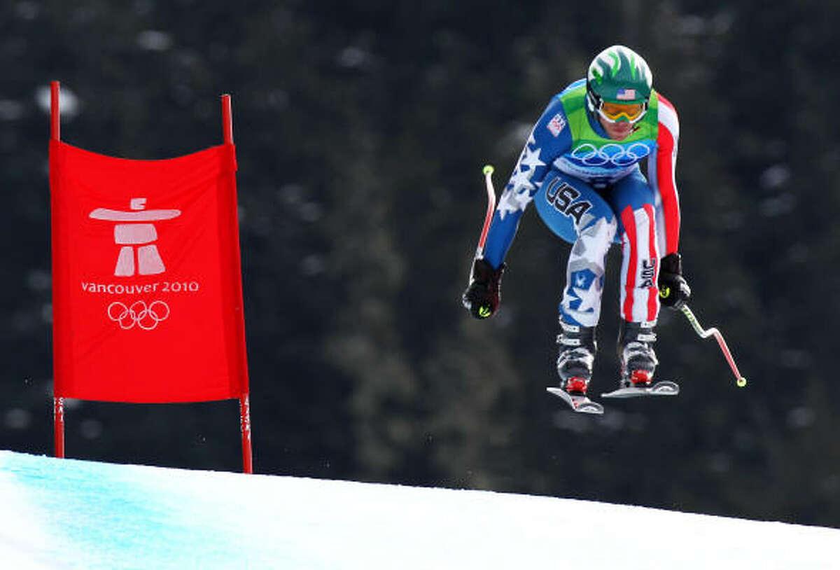American Bode Miller took the bronze in the men's downhill Monday, 0.09 seconds behind winner Didier Defago of Switzerland.