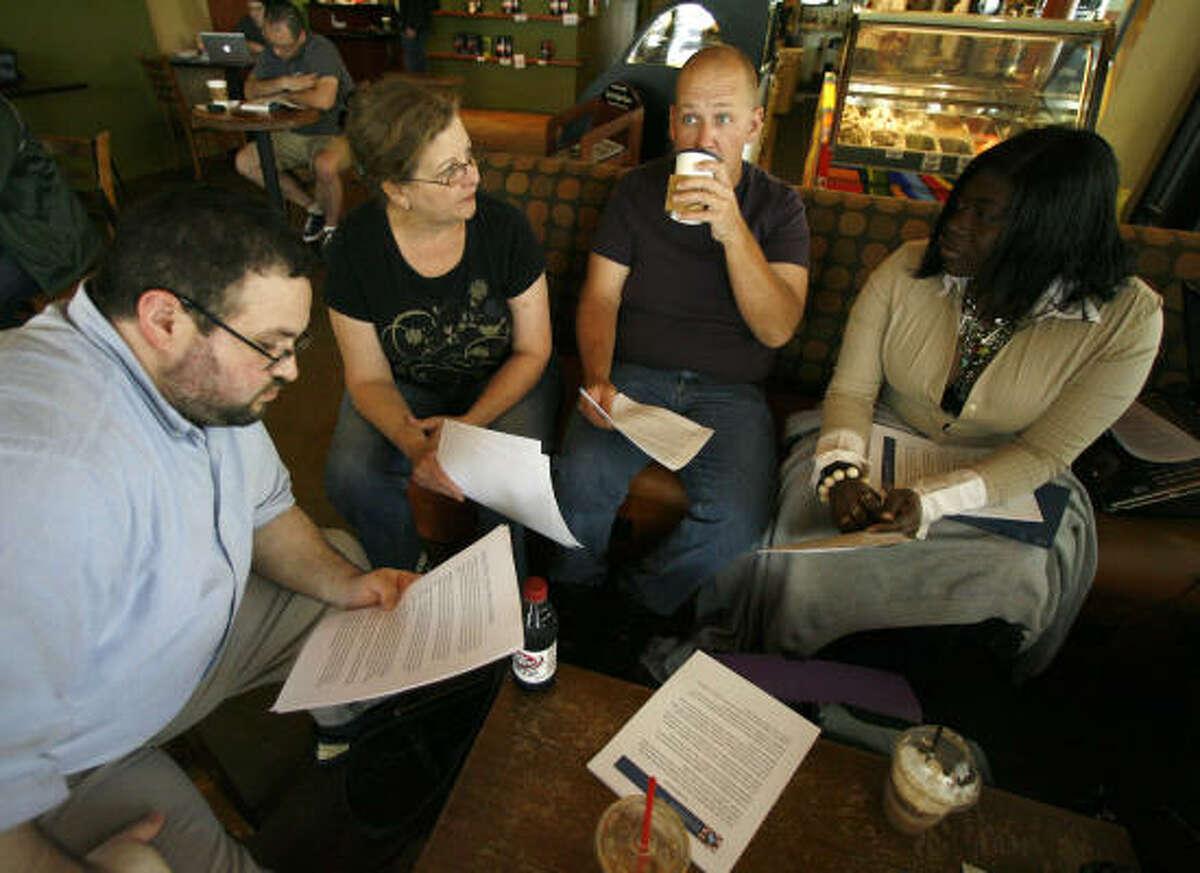 Bassel Samam, left, Jane Barwell, Brett Walker and Tenisha Idowu chat in Midtown during a coffee party meeting.