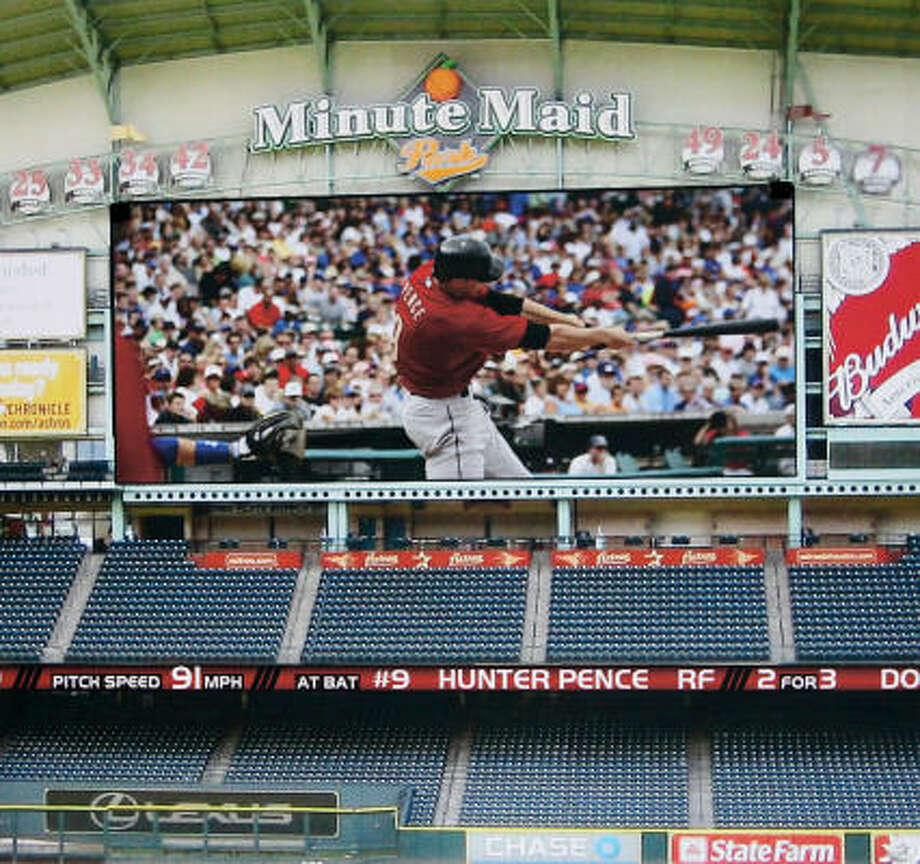 An artist's rendering depicts the proposed high-definition board at Minute Maid Park. The screen would be the second largest in Major League Baseball. Photo: Julio Cortez, Chronicle