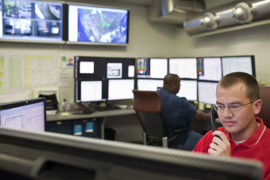 Matt Allen, an engineer, works at Shell's real-time operations center this month in Houston. The center monitors data from wells around the clock. Photo: Eric Kayne, For The Chronicle