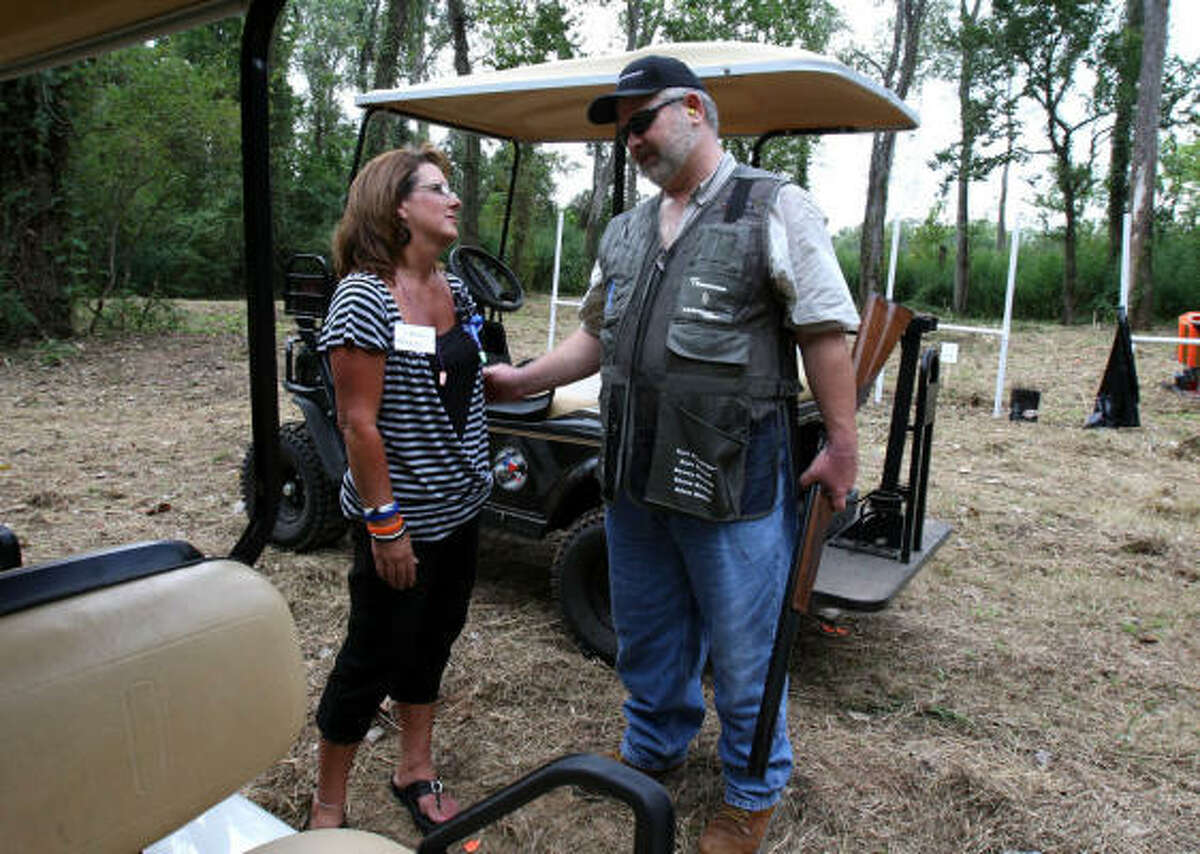 Mark Dreith, of Transocean, talks to Sherri Revette, whose husband, Dewey Revette, died during the Deepwater Horizon accident, Friday at the Bentley Ranch.