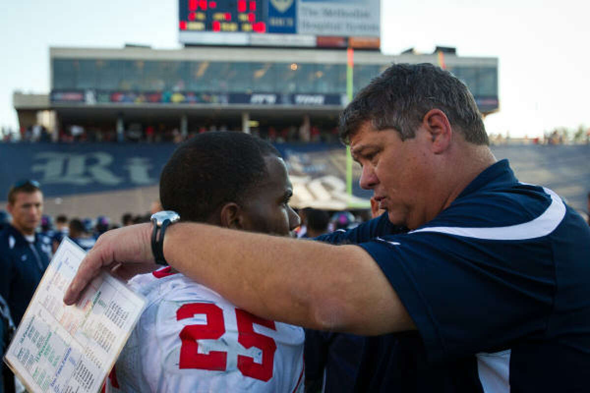 Rice coach David Bailiff consoles Houston running back Bryce Beall after Saturday's game at Rice Stadium.