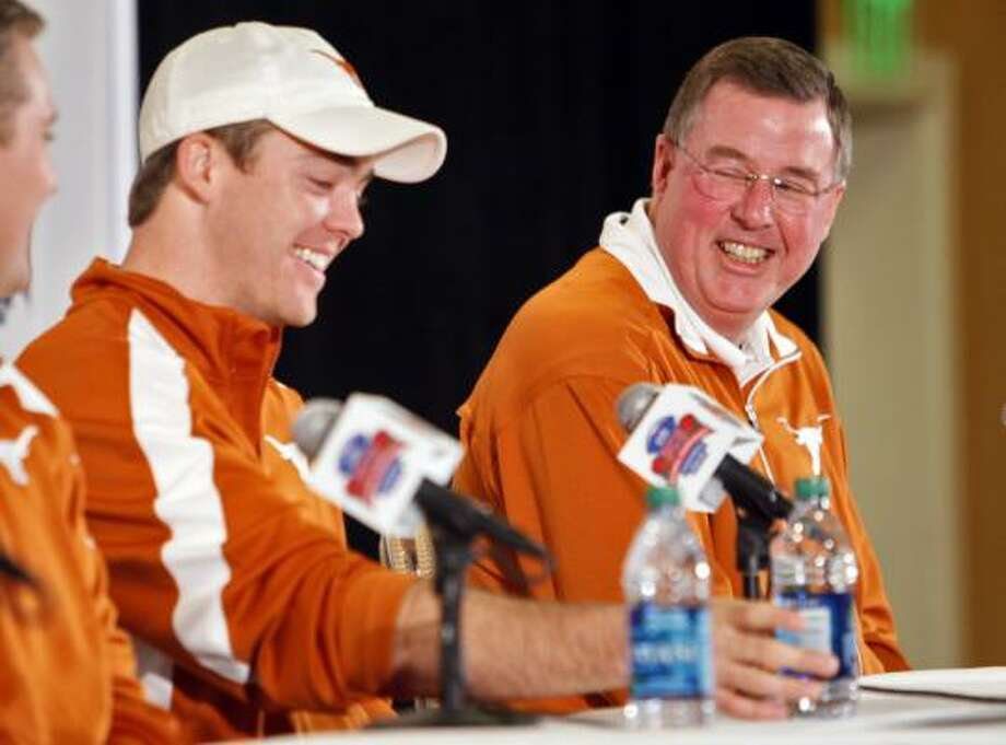 Greg Davis, right, had been with head coach Mack Brown for 13 seasons at Texas. Photo: Mark J. Terrill, AP