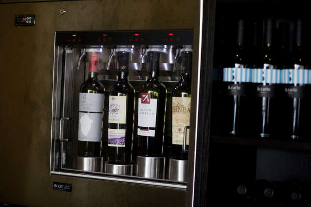 The Enomatic wine machine dispenses glasses of wine by injecting nitrogen into the bottle, which helps the flavors and characteristics of the wine remain intact for more than three weeks, as if the bottle had just been opened.