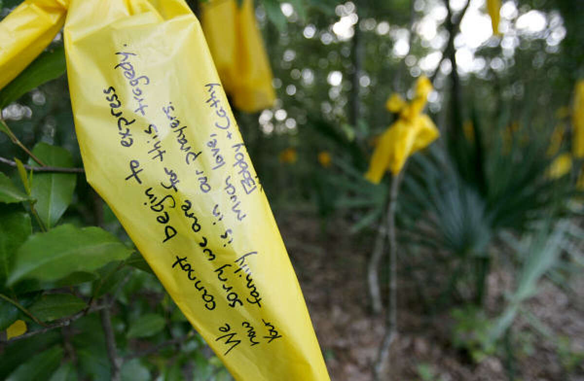 A yellow ribbon hangs on a tree in honor of Ryan at his home in the Bunker Hill area on Sunday.
