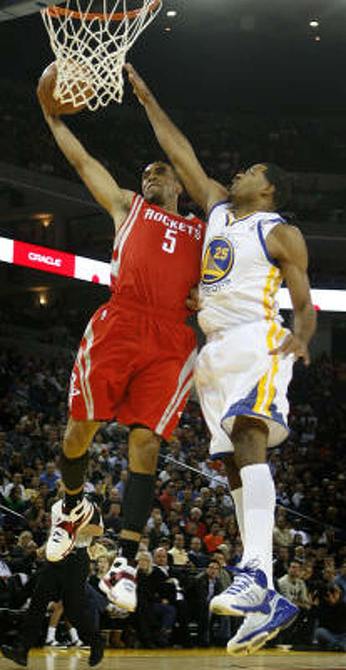 Rockets' Courtney Lee draws a foul from Warriors' Rodney Carney.