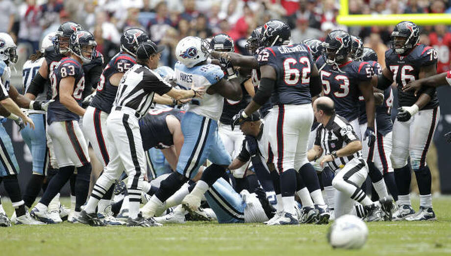 Texans and Titans players fight after Texans wide receiver Andre Johnson got into a fist fight with Titans cornerback Cortland Finnegan. Photo: Karen Warren, Chronicle