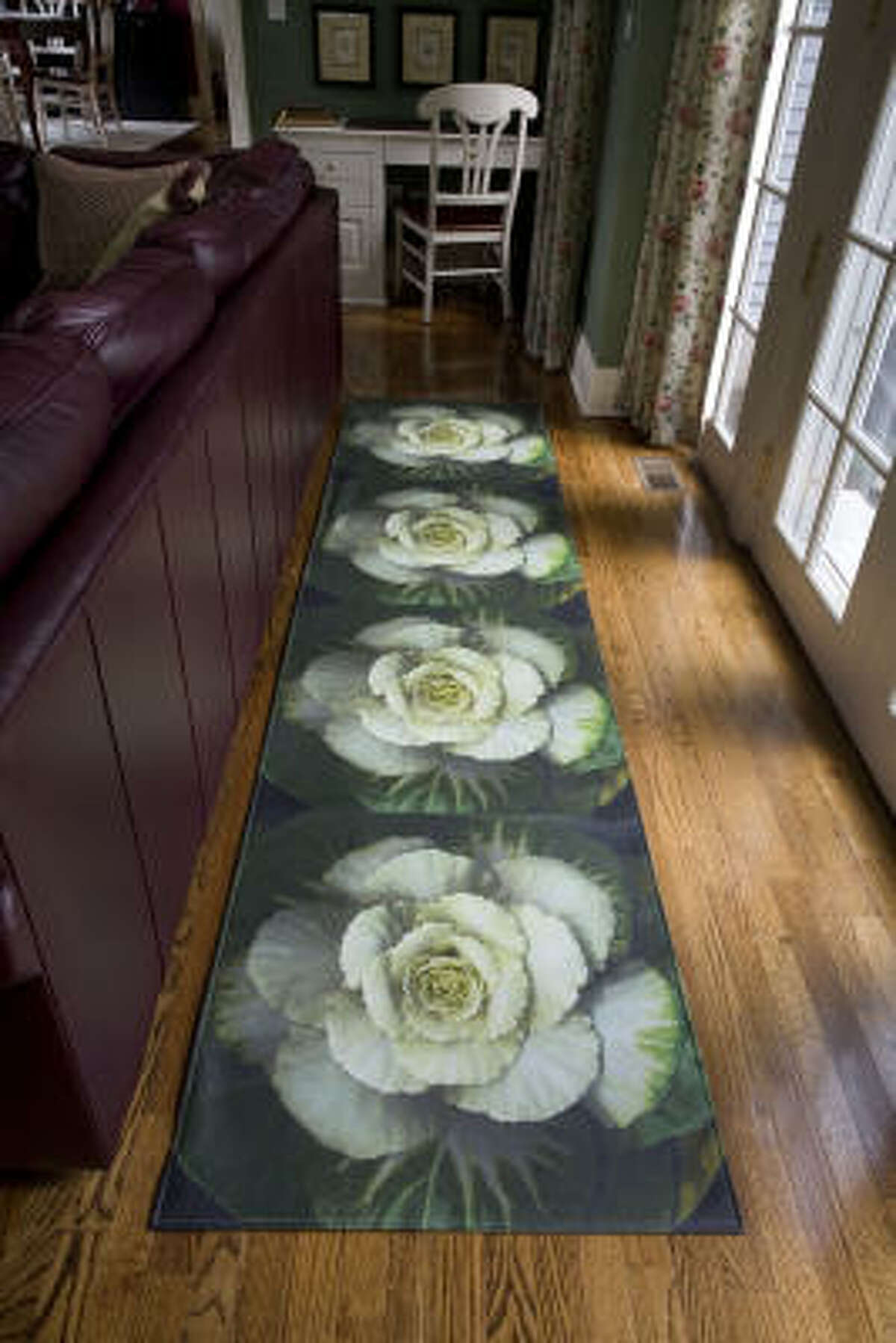 Step on it: Still as durable as traditional floorcloths, a contemporary version features photo close-ups.