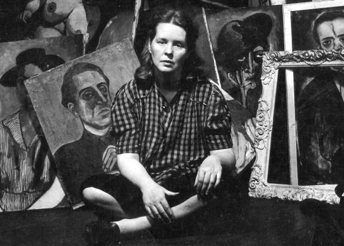 Artist Alice Neel, surrounded by her paintings in 1944, in a detail of a still from the documentary Alice Neel. Alice Neel in her Harlem studio, 1944 Photo Credit: SeeThink Productions / Sam Brody