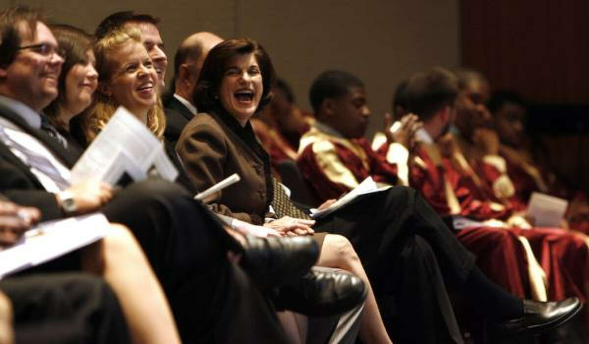 Luci Baines Johnson, center, reacts in laughter while sitting with members of Liz Carpenter's family Friday during the celebration of her life. Carpenter died March 20 in Austin at 89.