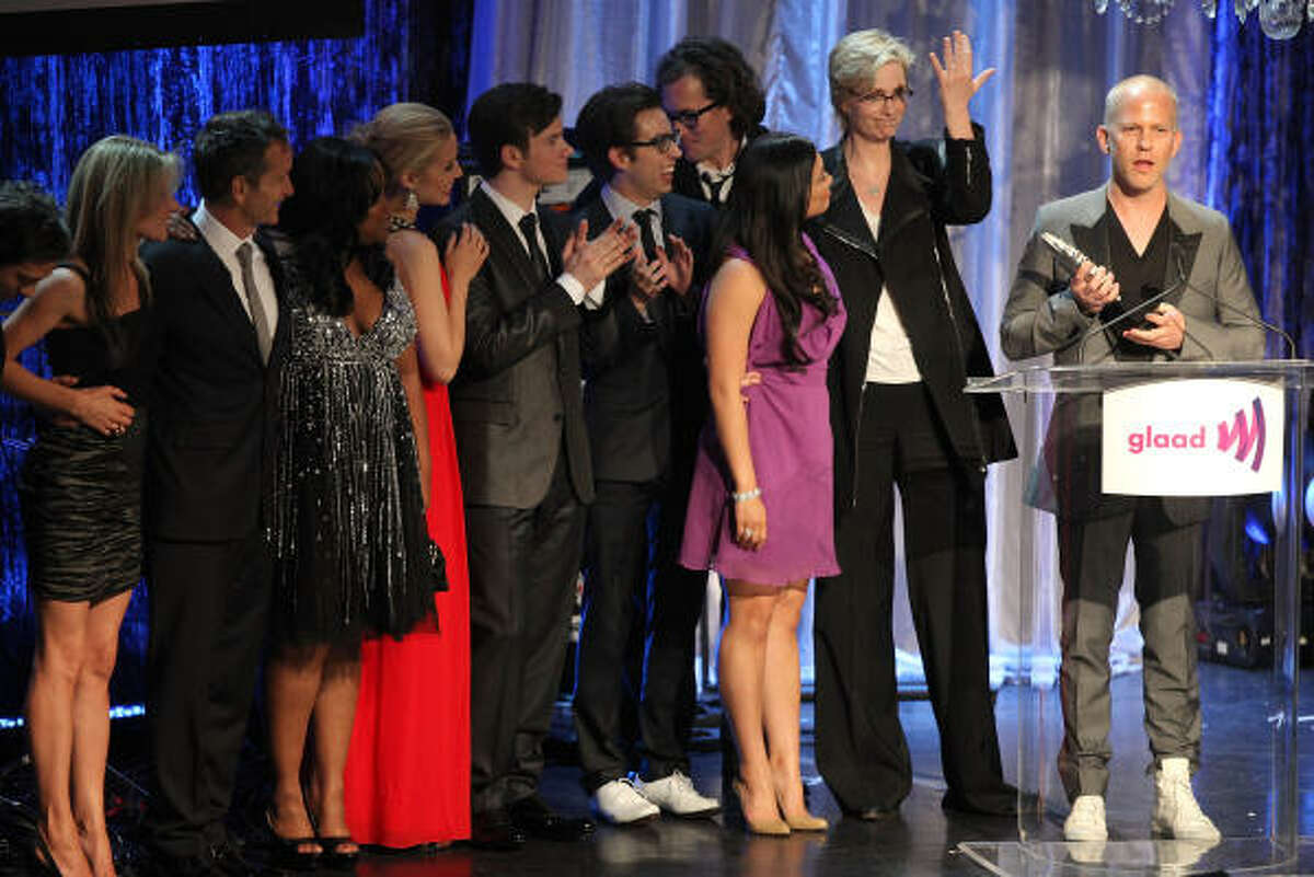 The cast of Glee and show creator Ryan Murphy accept their trophy Saturday at the 21st Annual GLAAD Media Awards in Century City, Calif. Murphy, in particular, praised lesbian actress Jane Lynch and gay actor Chris Colfer.