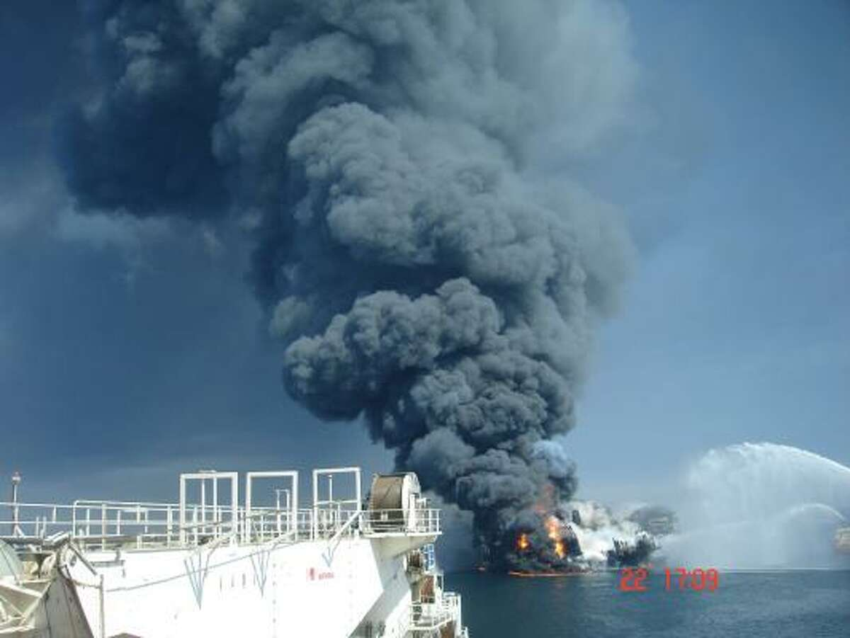In a photo the Chronicle obtained from an anonymous source, the Deepwater Horizon drilling rig sinks after the explosion Tuesday night.