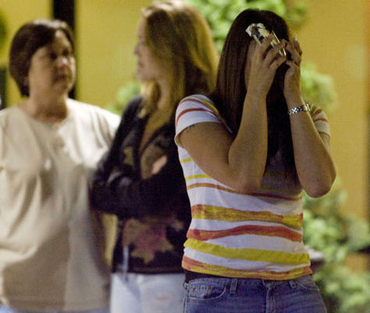 Micalet Kemp, right, throws her hands up in an act of emotion,Thursday April 22, 2010. At the Crowne Plaza hotel in Kenner La. knowing her loved one is still missing in the aftermath of the Deepwater Horizon oil rig explosion.