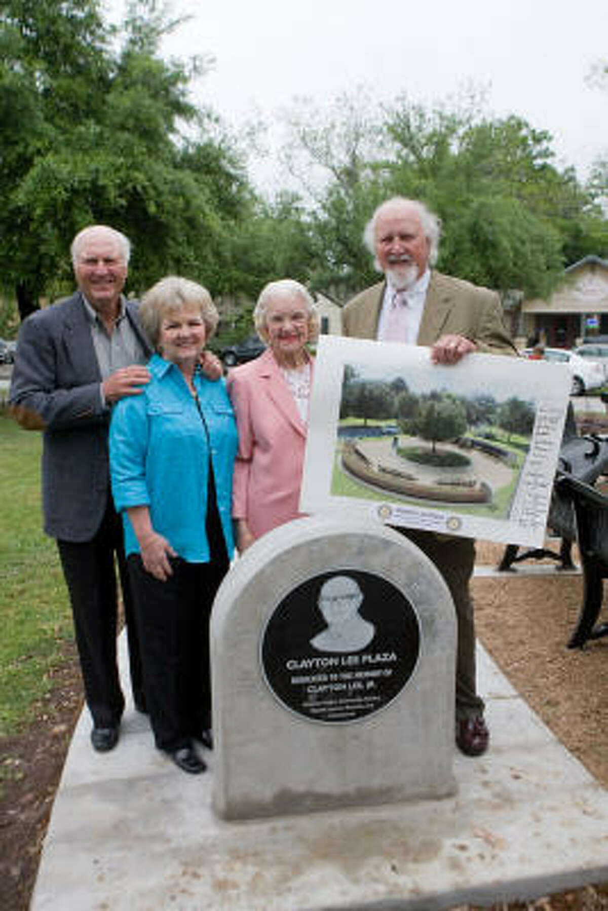 IN REMEMBRANCE: Attending the plaza dedication was the late Clayton Lee Jr.'s son, also named Clayton Jr., left, and his wife, Linda; Lee Jr.'s widow, Libby Lee, and son, Grady Lee.