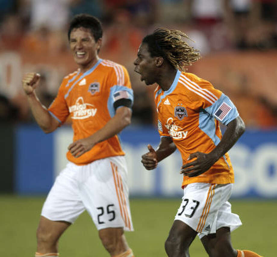 Dynamo forwards Joseph Ngwenya, right, Brian Ching celebrate Ngwenya's second-half goal. Photo: Bob Levey, Getty Images