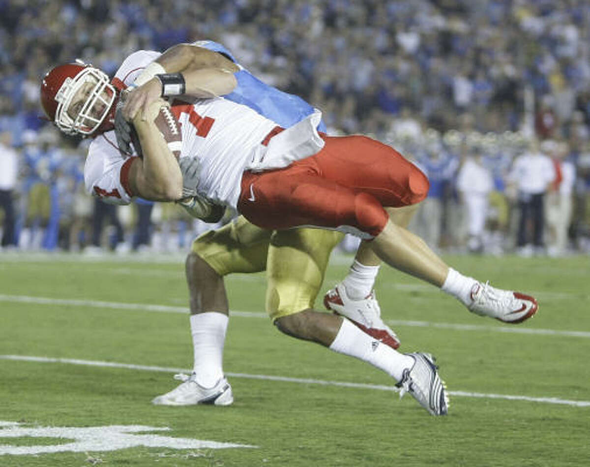UH's Case Keenum is slammed to the turf on the last possession he played in Saturday's game.
