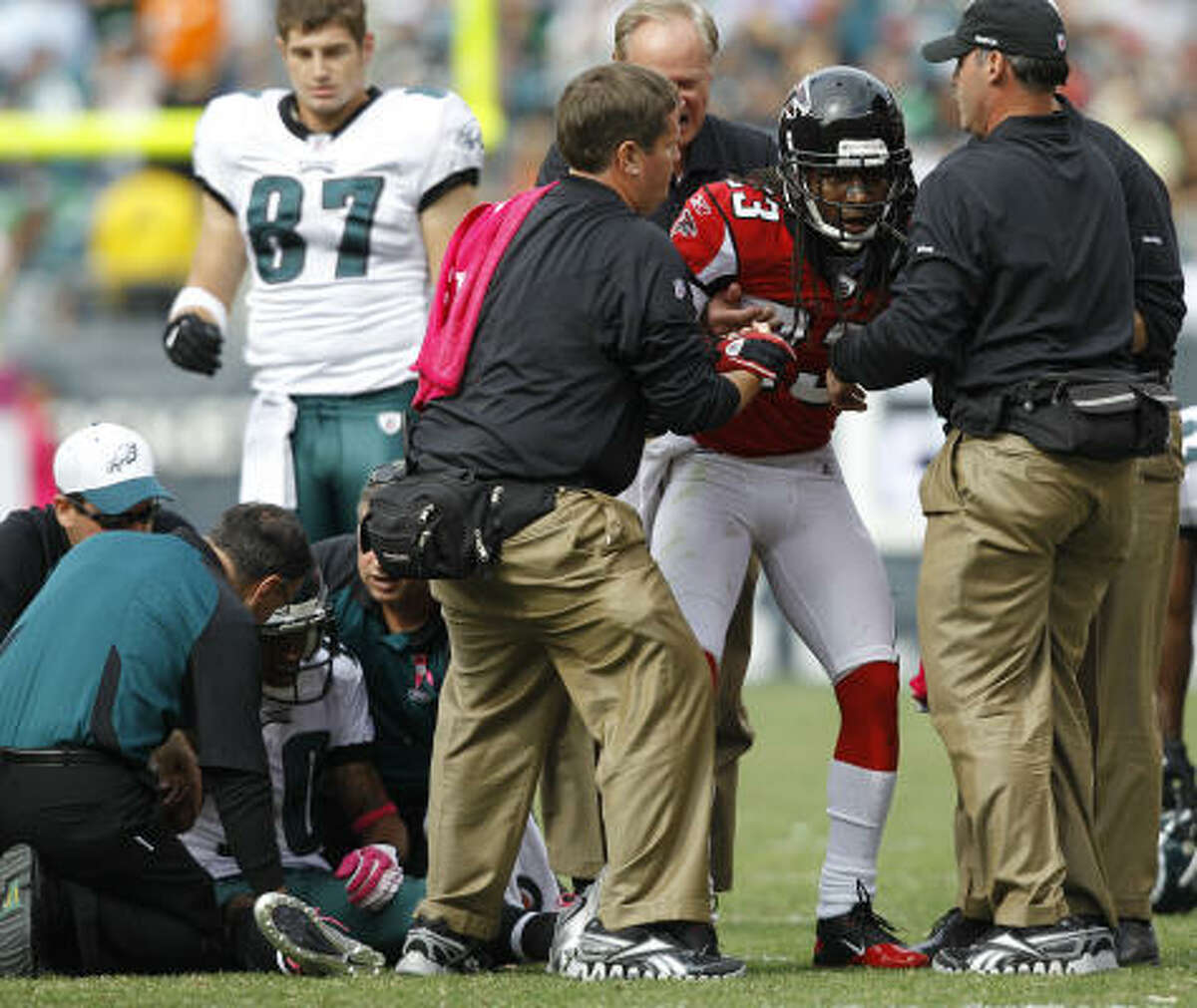 Atlanta's Dunta Robinson, right, and Philadelphia's DeSean Jackson both had to be helped up after Robinson's big hit on Sunday.