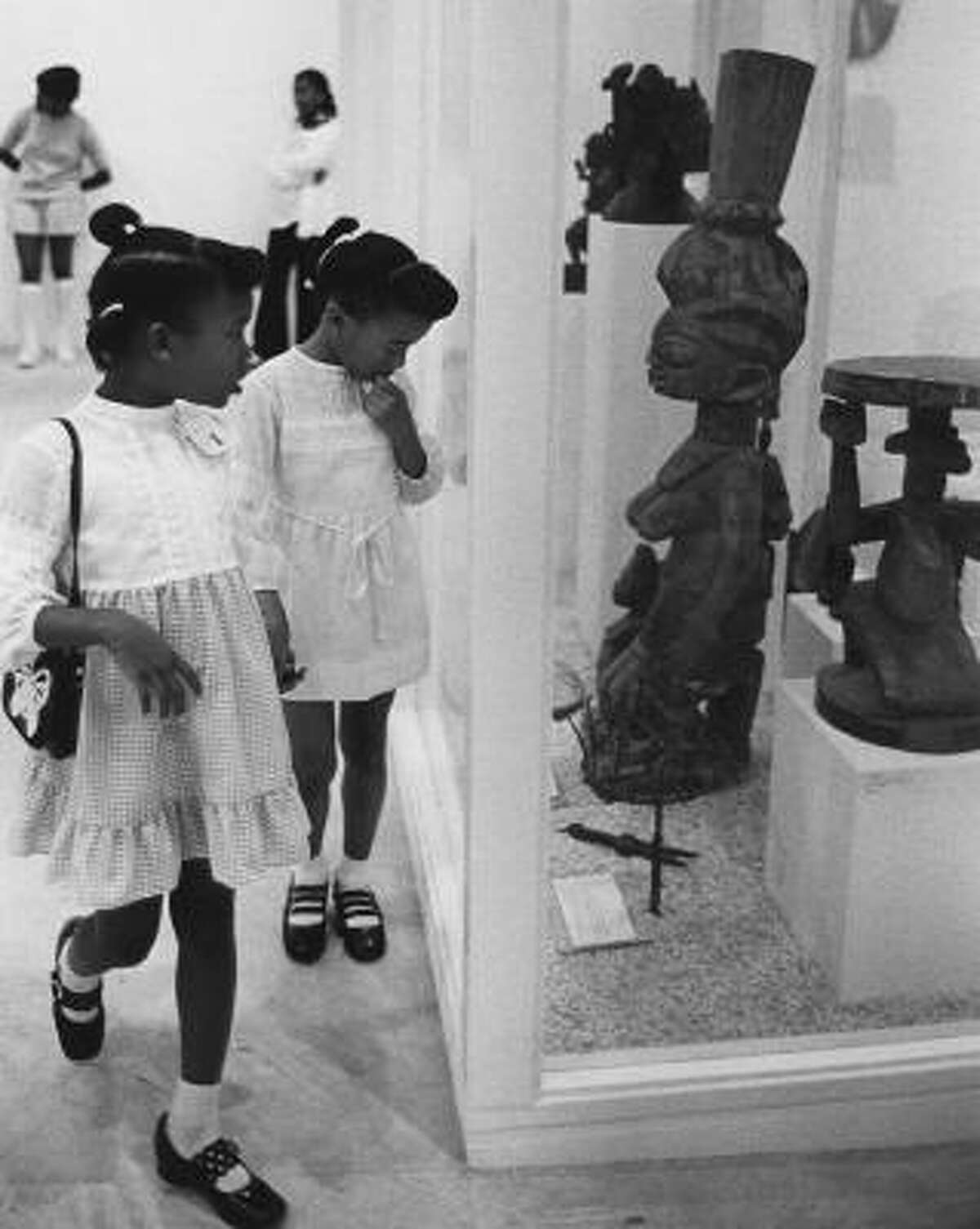 Children visit the 1973 exhibit Tribal Art of Africa at the Black Arts Gallery at the De Luxe Theater. This photograph is included in the new book Art and Activism: Projects of John and Dominique de Menil.