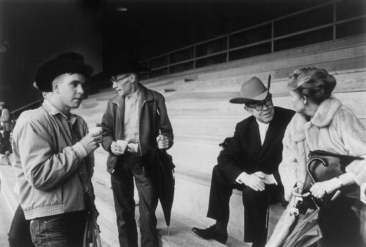 Cowboys, from left, Father John Meyer, René Magritte and Dominique de Menil visit during a rodeo in Simonton in 1965. The de Menils acquired more than 50 Magritte works during their lifetimes.
