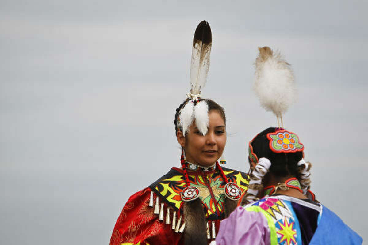 Angela Butler, left, and cousin Julianne Butler were among the performers Sunday in the 21st Annual Texas Championship Pow Wow at Traders Village in Cypress.