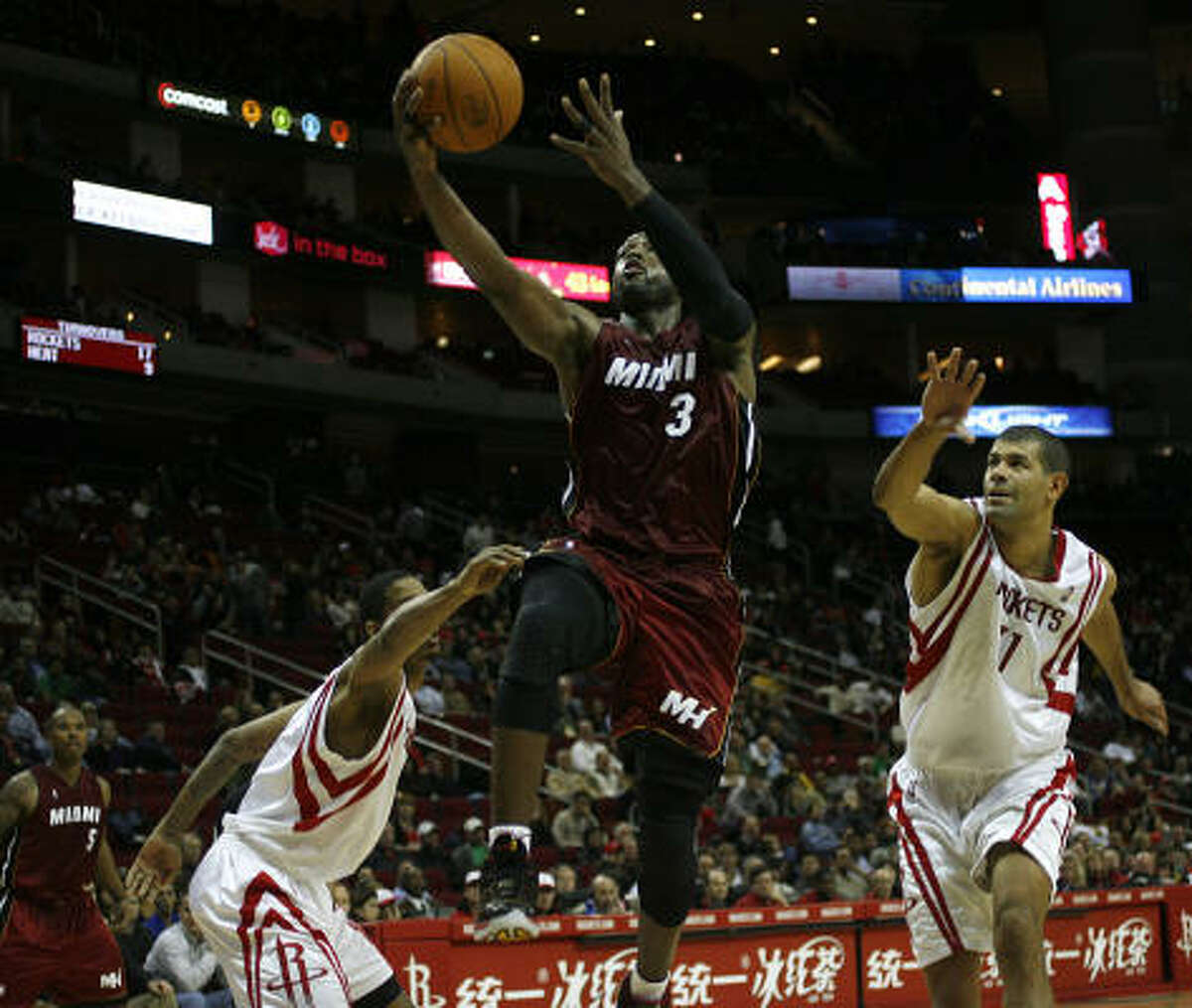 Heat guard Dwayne Wade sliced through the Rockets' defense on his way to 37 points in Miami's win.