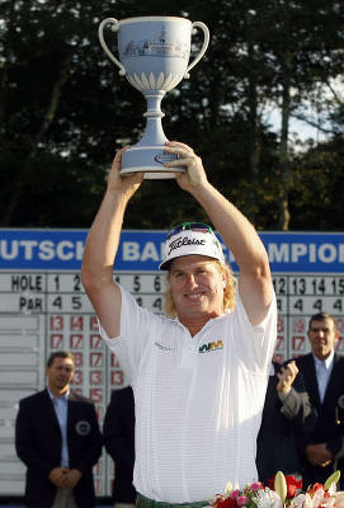 Charley Hoffman raises the trophy for winning the Deutsche Bank Championship.