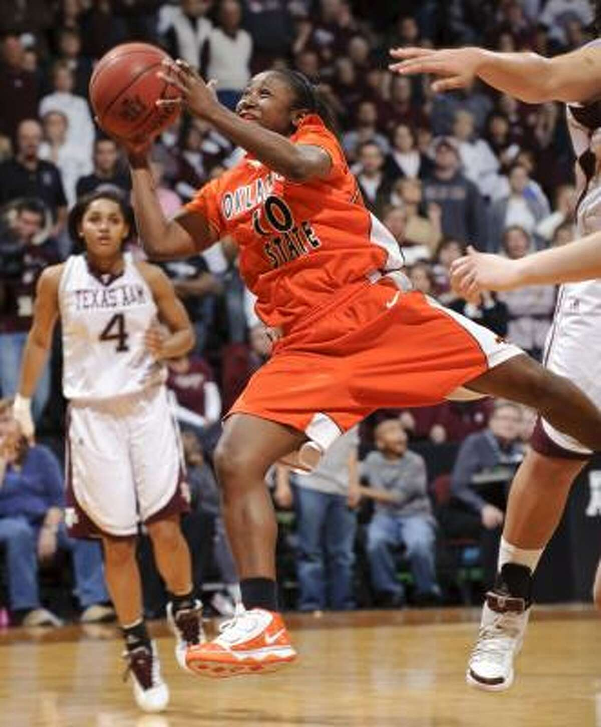 Oklahoma State's Andrea Riley scored 31 points for the Cowgirls.