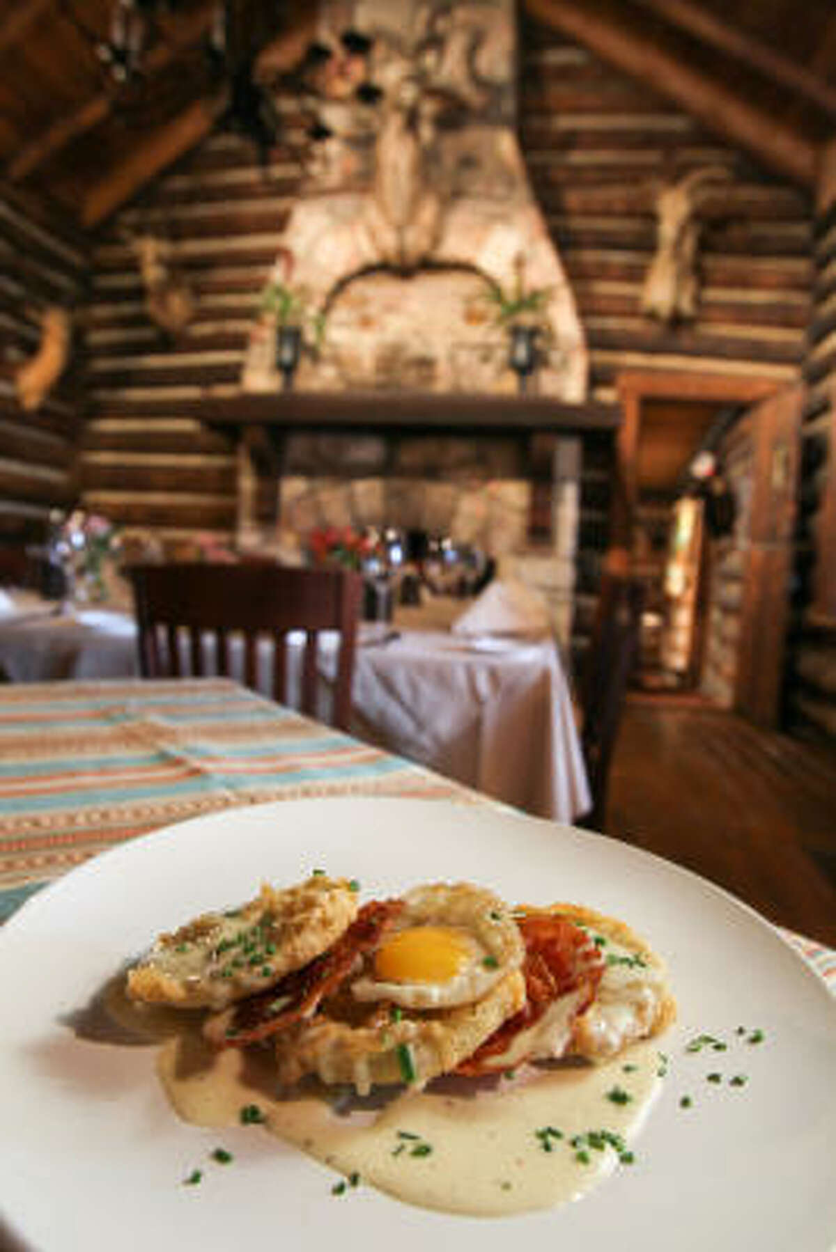 Rainbow Lodge's dinner appetizer menu includes a dish with fried green tomatoes, pancetta and a quail egg served with a country-style gravy.