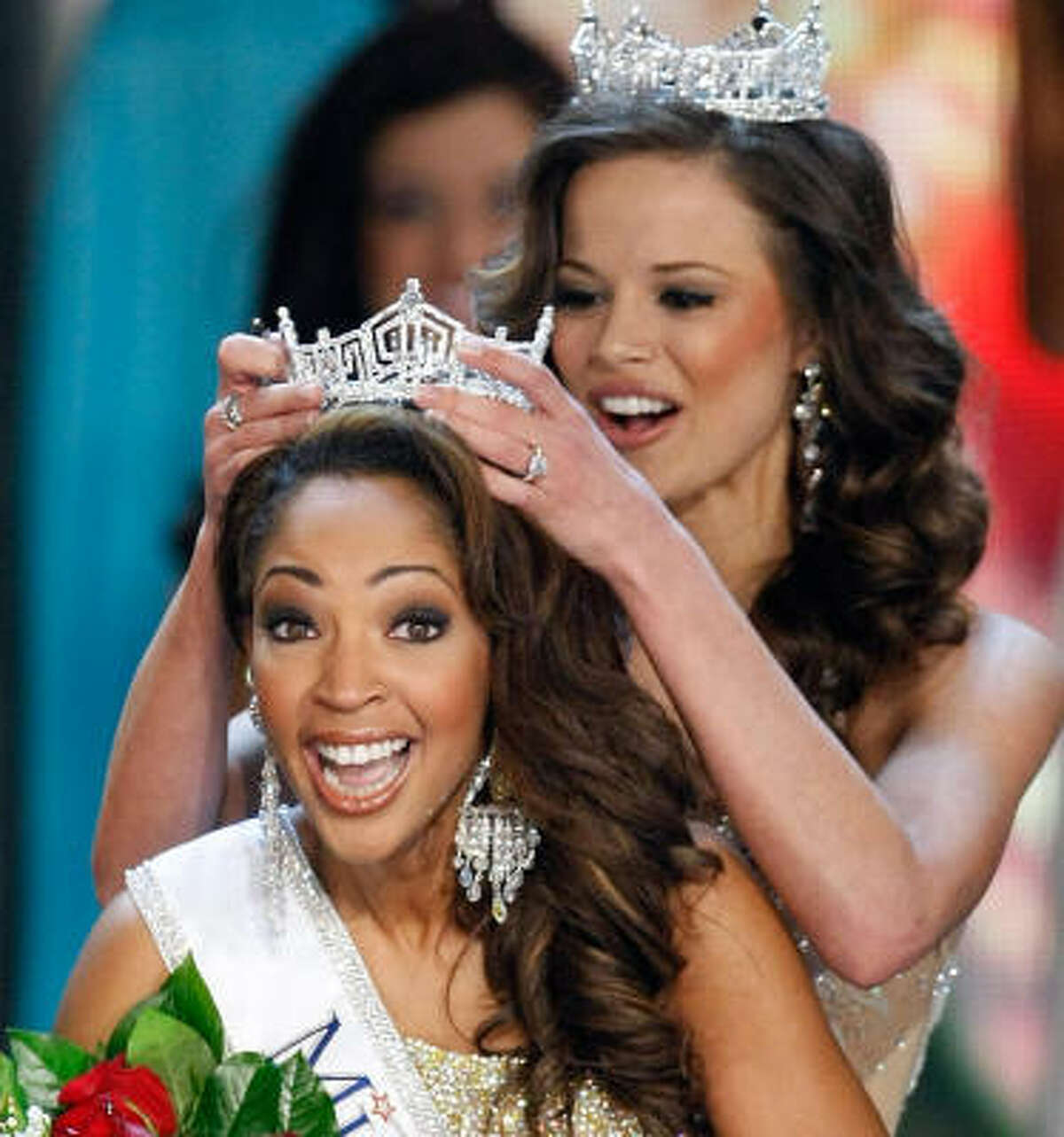 Miss America 2009 Katie Stam passes the crown to Virginia's Caressa Cameron in Las Vegas on Saturday.