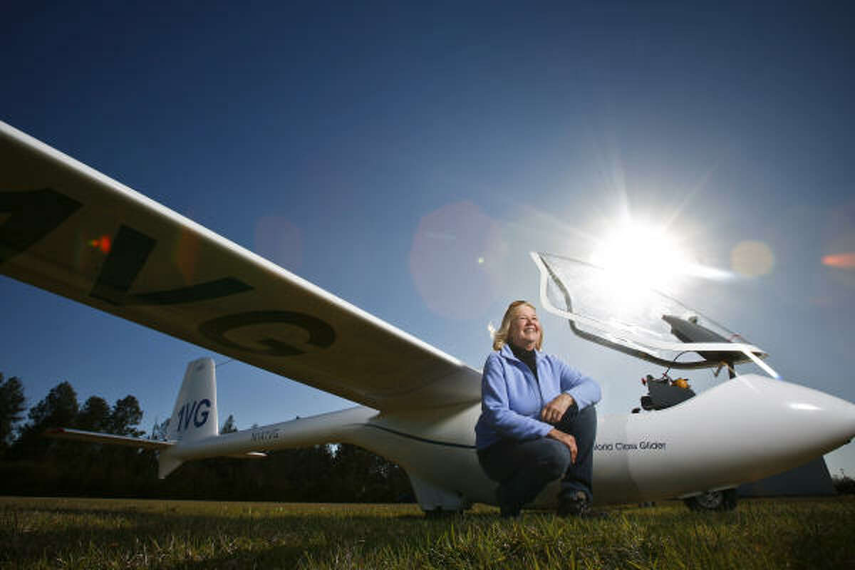 Val Paget stands next to the World Class Medium Performance PW5 glider in Waller that she used in last year's record-setting flight