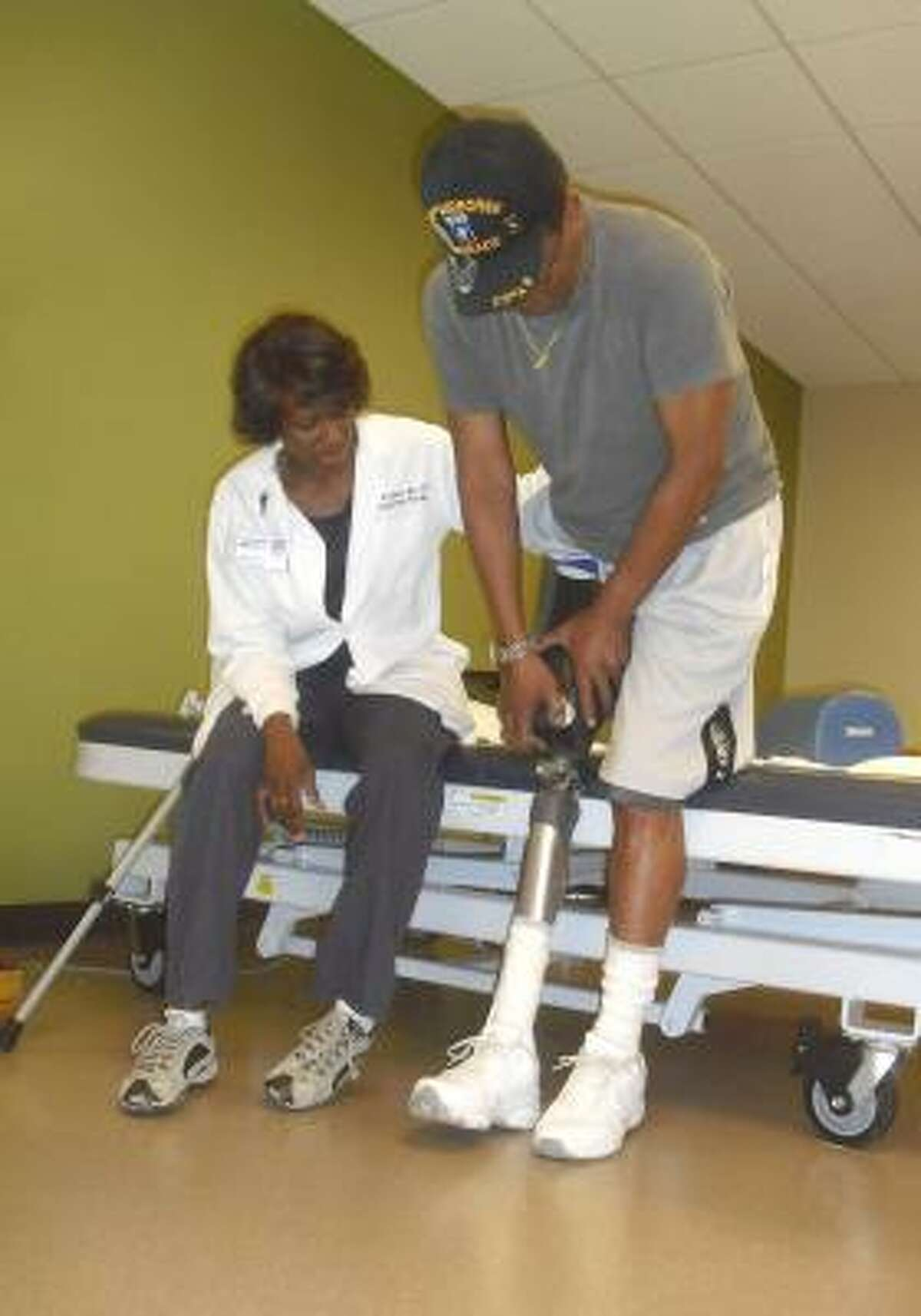 SKILLS FOR LIVING: Judith Jenkins, OTR, MA, a senior occupational therapist at The Methodist Hospital, works with Jeffrey Barnes, who has had a prosthetic leg for the past seven months.