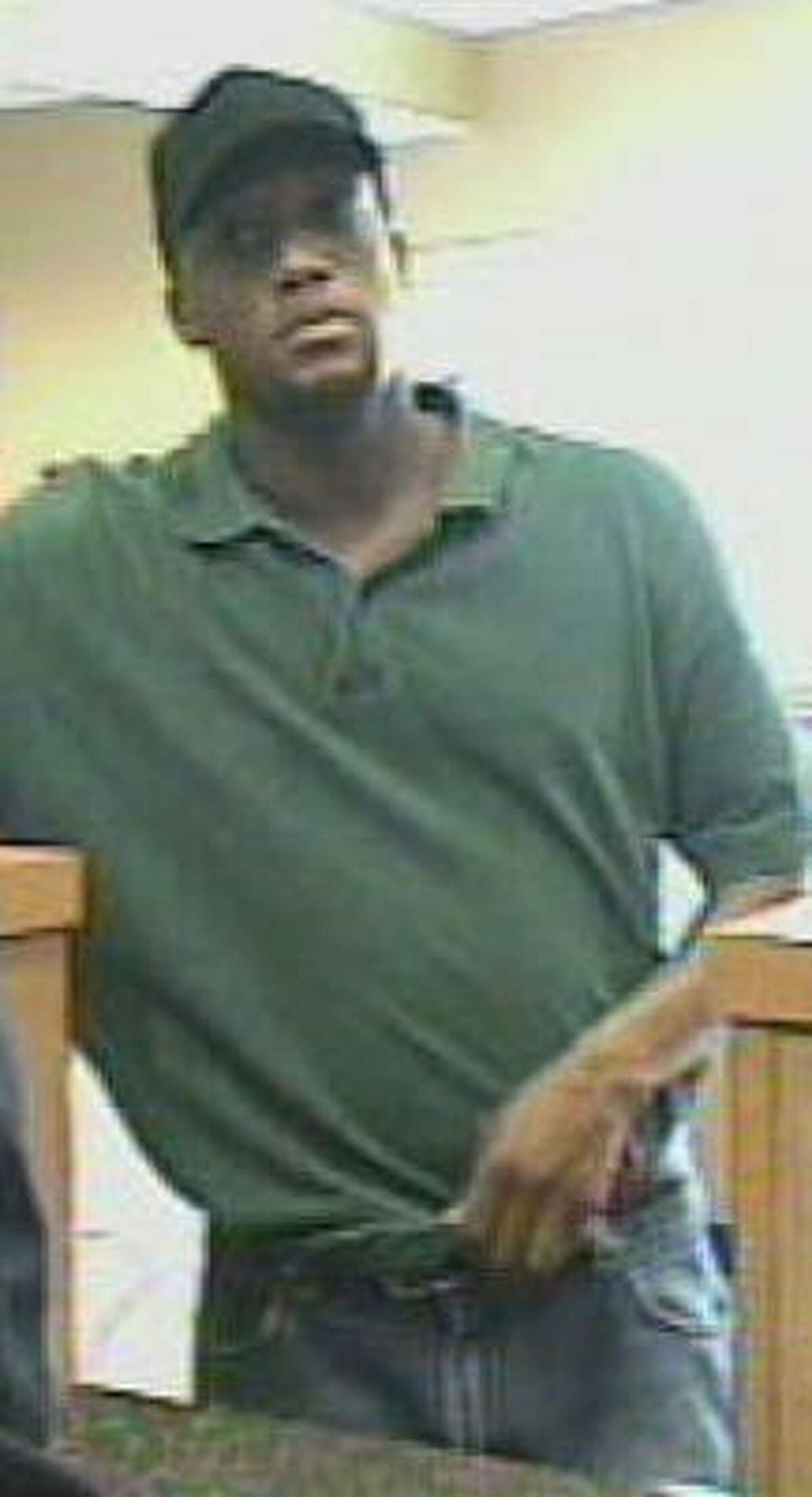 The FBI is looking for this man, whose image appears on surveillance video taken at a Harris County bank that was robbed Monday morning.