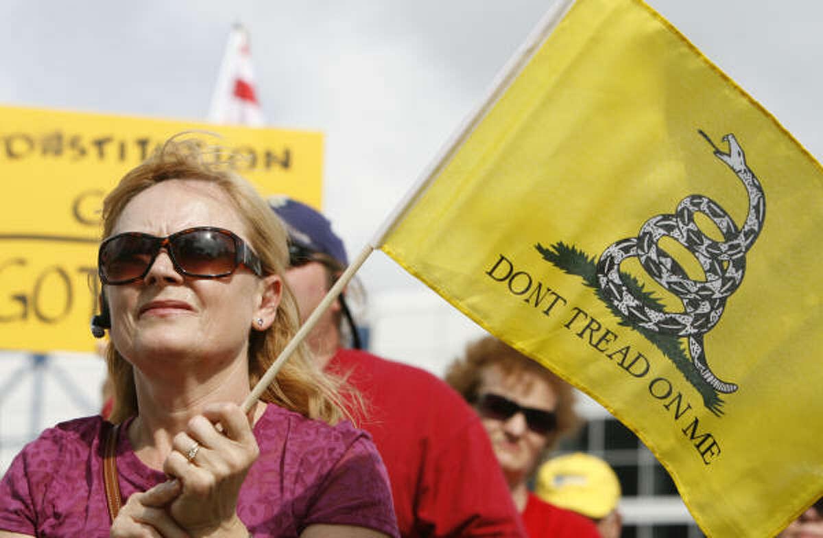 Tatyana Topanov waves her flag at the rally.