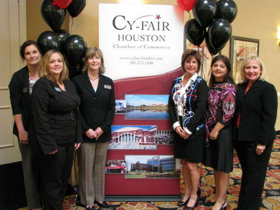 NEW LOOK: Cy-Fair Houston Chamber of Commerce participated Sept. 21 in the unveiling of a new logo. Staff joined the logo creator at the recent meeting. From left are Cindy Downey, Jennifer Ellis, Casey Cargle, Paula Harvey, Leah Dossey, owner Blueleaf Creative; and Mary Evans, chamber president. Photo: Cy-Fair Houston Chamber