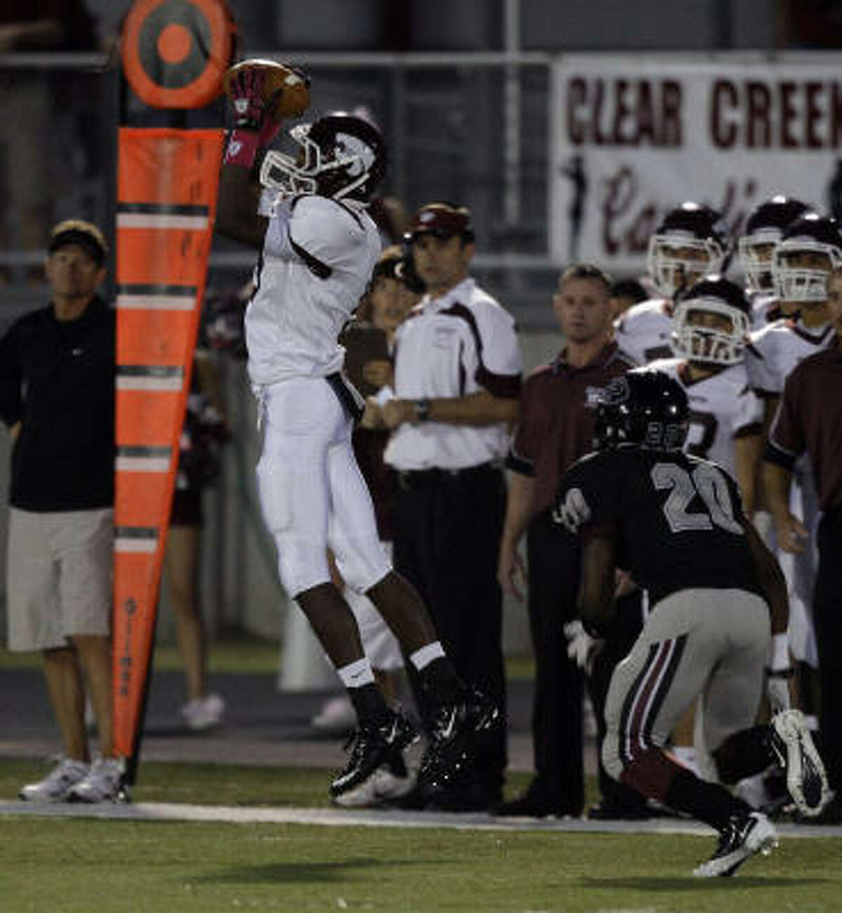 Clear Creek's Dion Lewis hauls in a pass in front of Pearland's Jessie Rayford.