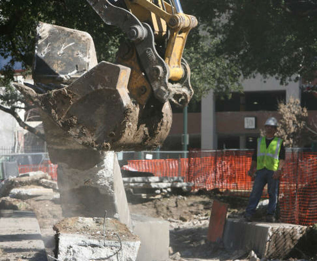 Heavy equipment rips through the old improvements to Market Square to make way for a $3 million redesign. The update includes input from downtown workers and residents.