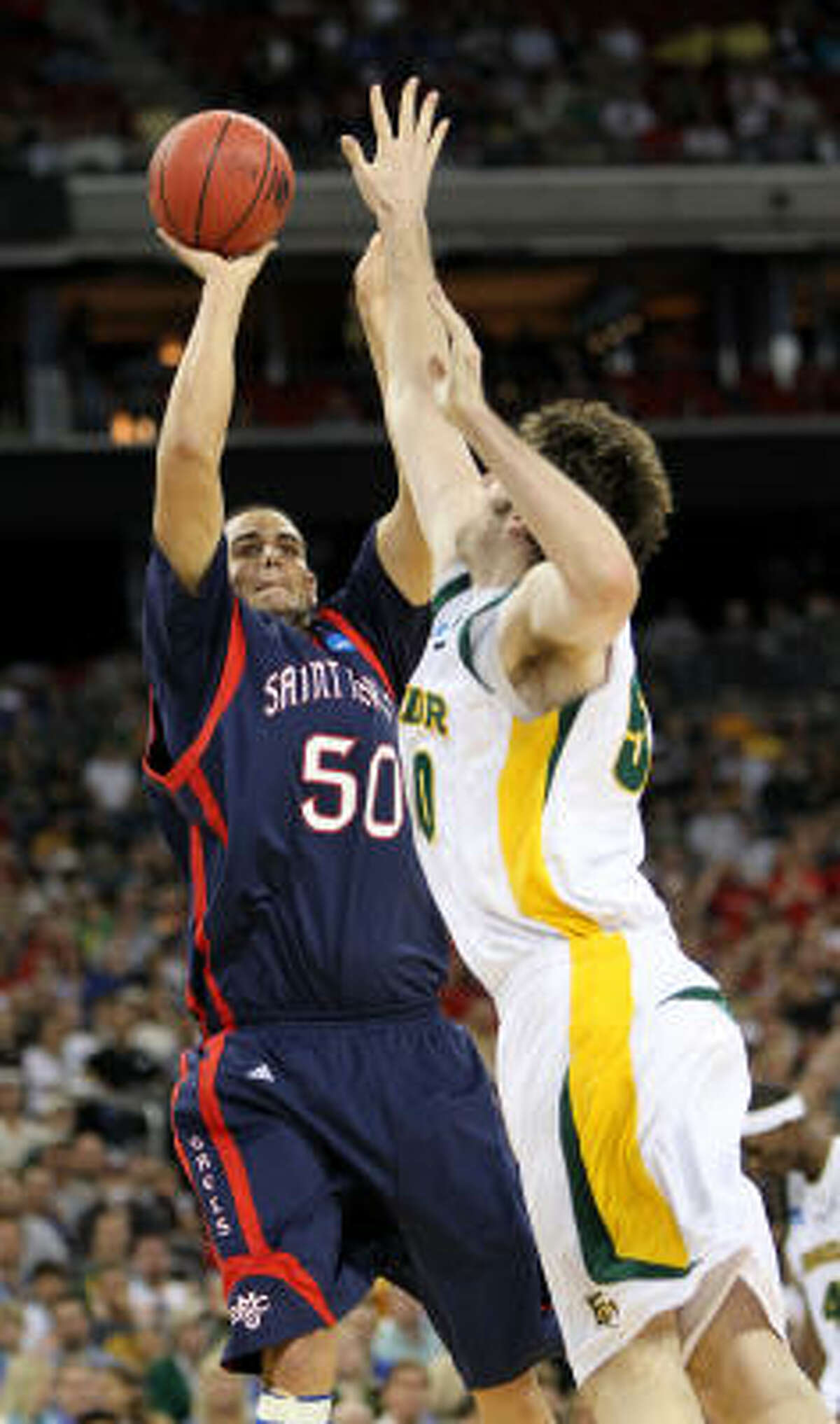 Saint Mary's Omar Samhan (50) felt the pressure from Baylor players such as Josh Lomers all night Friday.