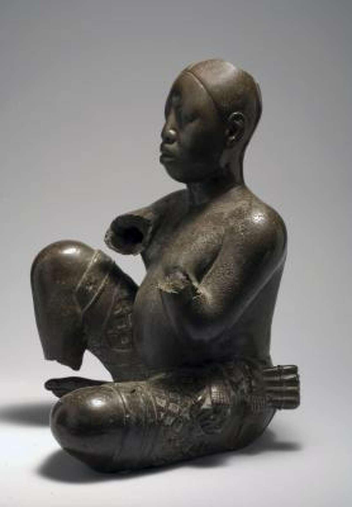 Seated figure Tada, late 13th-14th century Copper