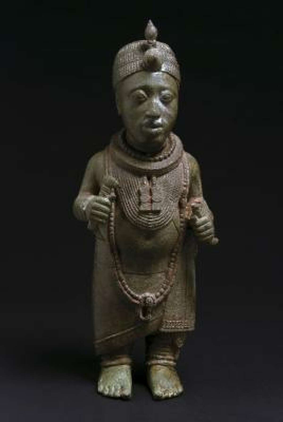 Figure of a king Ita Yemoo, Ife, 14th century, copper alloy