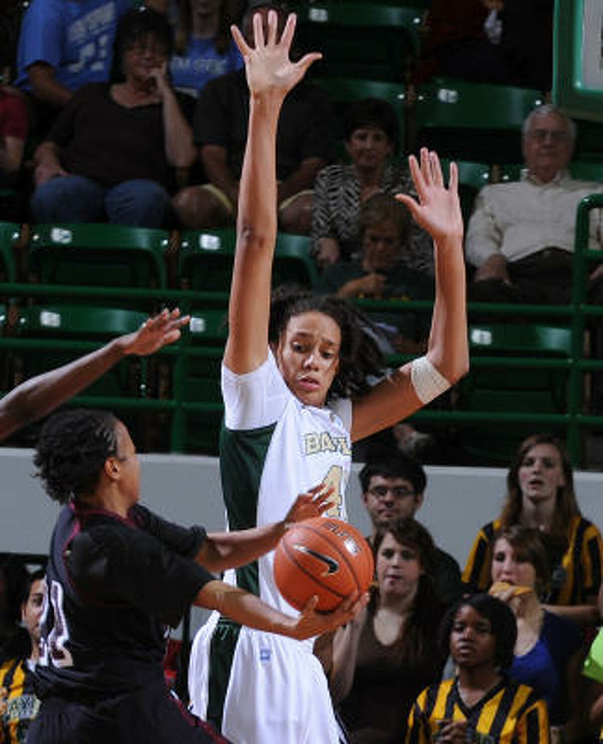 Baylor's Brittney Griner, right, goes up to block the shot of Texas Southern's Jasmine Cannon, left, during the second half on Tuesday night. Griner had three blocked shots to set a school career record.