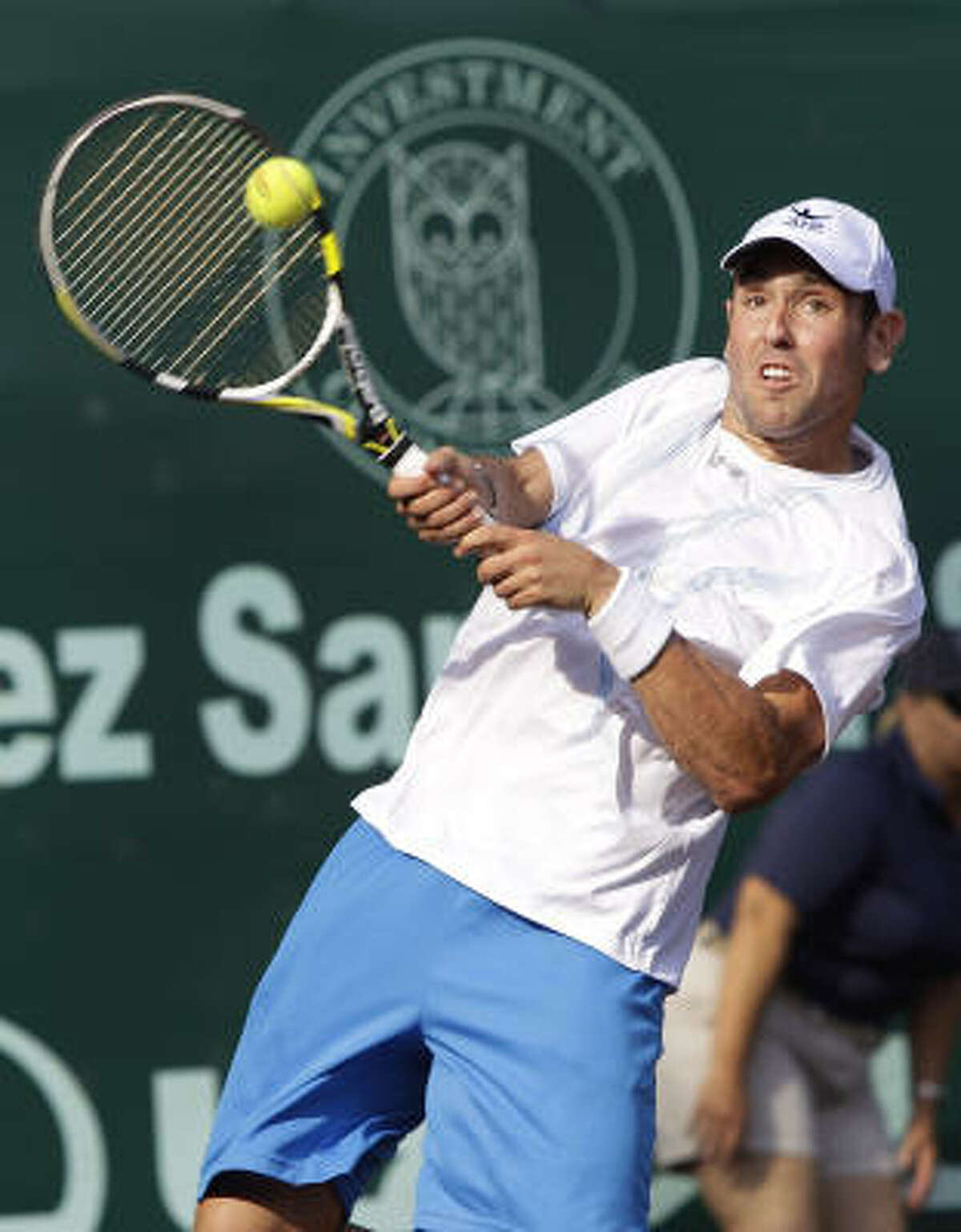 Wayne Odesnik hits a return against Jerzy Janowicz at River Oaks Country Club.