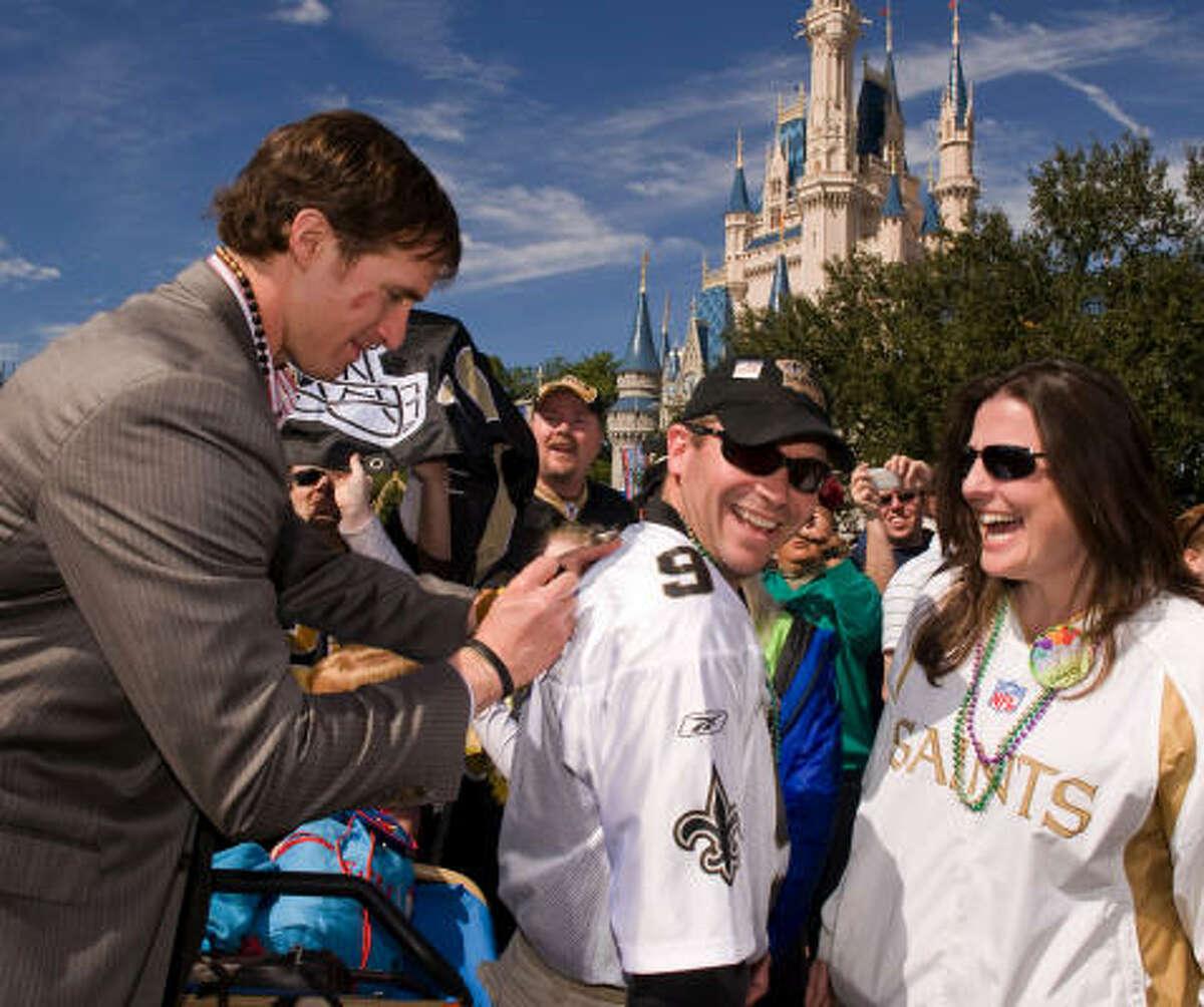 Super Bowl MVP Drew Brees, left, said Saints fans gave the team strength all season.